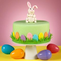 Bunny Hop Along Easter Cake - Follow the cottontail down the bunny trail to this sweet Easter cake. This special cake is sided with colorful eggs made with our 12-Pc. Easter Mini Cutter Set.