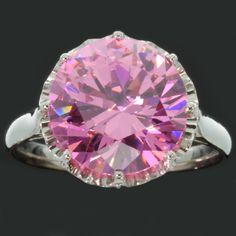 Estate platinum engagement ring with big pink stone