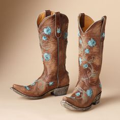 """Romantic as a dozen roses, far more lasting, Old Gringo's tall leather boots are stitched and appliqued with deftly folded leather blooms. 1-1/2"""" heel. Imported. Whole sizes 6 to 11.View our entire Old Gringo Collection."""