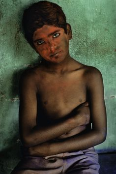 This boy was photographed in India during the Holi festivities.