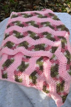 This is a pink with pink camouflage swaddling blanket. Size is approximately 35 inches by 23 inches. 100% Acrylic.
