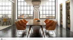 Architectural details are key to the private conference room. The creative use of contemporary pendant bulb chandelier with the designer walnut table. The orange fabric tub chairs contrast against the black parquet flooring. Built in book shelves with concealed lighting mirror the large floor to ceiling mill windows. Office idea by http://www.setvisionspix.co.uk/