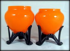 A fantastic pair of eye-wateringly bright orange glass bowls, made in Bohemia or the Czech Republic between 1910-30. Description from etsy.com. I searched for this on bing.com/images