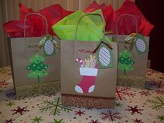 Decorate plain kraft gift bags with Cricut images and stamping!