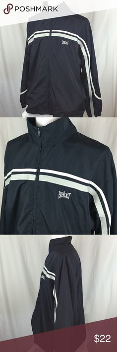 "Everlast Men's Navy Blue Workout Track Jacket Awesome Everlast Men's Navy Blue Workout Track Jacket. One white stripe and a gray stripe across the front down the sleeves. Size men's extra large in great condition. 29"" long and 24.5"" across the chest Everlast Jackets & Coats"