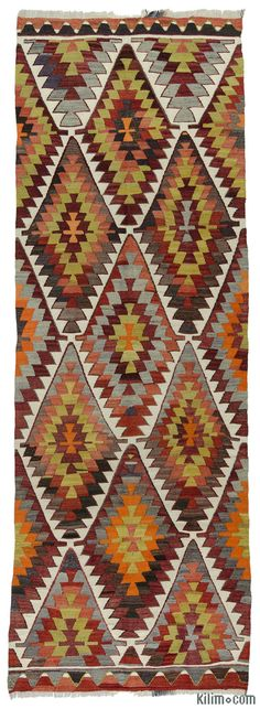 Vintage hand-woven Turkish kilim runner rug around 40 years old and in very good condition.