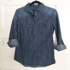 J. Crew denim shirt This polka dot denim shirt is the perfect piece to layer, or wear alone. It's in excellent condition. It's only been worn one time. It's faded on the shoulders (that's how it came) and down the top part of the back. See pictures for details. J. Crew Tops Button Down Shirts