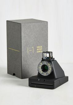 Impossible I-1 Camera. Pose, snap, and admire all in mere moments with this Impossible I-1 instant camera! #black #wedding #modcloth