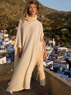 White Out Sweater Kaftan   Made in Ohio, this so soft and comfy sweater kaftan features a turtleneck with ribbed detailing. Tie accents at sleeve openings.  Super slouchy, oversized silhouette.