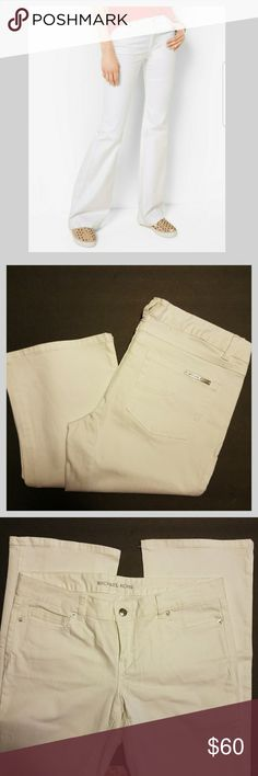 "NWOT- Michael Kors White Flare Jeans New Without Tags - Michael Kors White Flare Jeans  Size 4,  32"" inseam  98% Cotton 2% Spandex so there's a nice stretch or give to them  Bundle and save in my closet Michael Kors Pants Boot Cut & Flare"