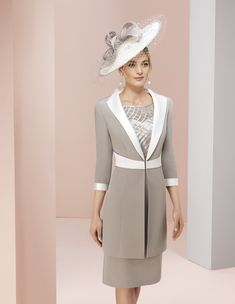 New style in store from January by Marfil. Ideal for a mother of the bride or groom or any special wedding guest. Soft beige and ivory dress and coat in a classic style with matching hatinator. 40 plus ladies fashion. Falkirk, Scotland. www.froxoffalkirk.com