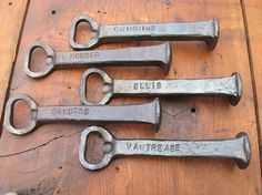 Hand forged railroad spike bottle opener, stamped with each groomsman's name