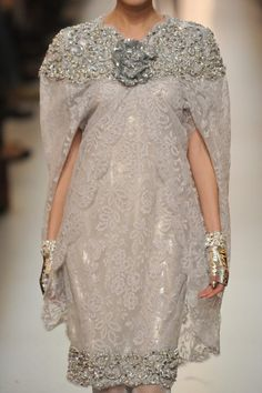 Chanel (The gloves and the jeweled bit up top and the fact that is is a cape = awesome.)