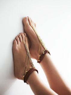 Summer Lovin Anklet Set | In a vintage-inspired, boho design, this set of two anklets features a cotton body and cascading metal accents. Toe loop detail and lobster clasp closure for an effortless fit.