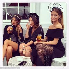 Chic in all black: Millie posed for photographs with her stylish friends at the event...