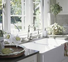 love this farmhouse kitchen sink that is divided for practicality!