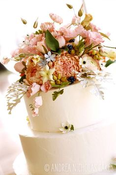 Andrea Nicholas Cakes ♥ Three-tiered wedding cake with a full sugar floral topper bouquet of peach peonies, pink sweet peas, cream stephanotis, and greens.