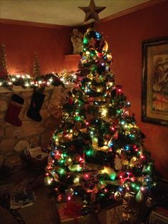 Multi Colored light Christmas tree with the Traditional Christmas ...