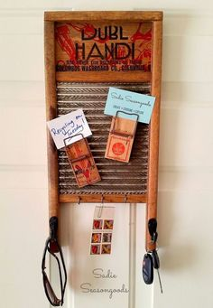 Create a modern organizer with an vintage washboard, mousetraps and hooks - genius!