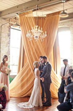 Rustic yellow romantic ceremony backdrop