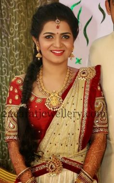 Telugu TV anchor Divya Darshini wearing temple jewellery at their wedding reception party. Gold round swirls and round kundan work motifs...