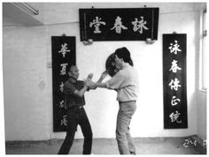 Samuel Kwok (right) and IP Ching (left), Son of IP Man. Grandmaster Ip Ching, born in 1936 is the youngest son of Ip Man.  http://www.kwokwingchun.co.uk/