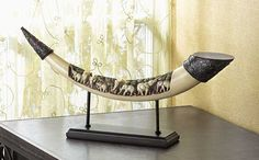 Lucky Elephants Tusk Sculpture – A family of elephants pauses beneath a mighty banyan grove, taking the time to enjoy the cool shade - and a luscious leafy mid-day meal! Faux-ivory tusk makes a wonderfully worldly focus piece, adding a touch of the wild to your decor. $32.50 + FS= 34% Savings. Retail: $49.95