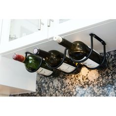 An under-cabinet wine rack because having vino in an easy-to-reach place is adult rule number one. 33 Kitchen Products For Anyone Who Basically Has No Cabinet Space Organisation Hacks, Organizing Tips, Camping Organization, Wine Bottle Rack, Bottle Holders, Wine Bottles, Wine Decanter, Small Kitchen Organization, Kitchen Hacks