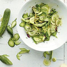 Cucumber Salad | MyRecipes.com - 4g Carbs, 1g Protein, 7g Fat - EVOO, white wine, lemon juice, salt, pepper, sugar, red bell pepper, green bell pepper, fresh chives.  fresh flat-leaf parsley , English cucumber