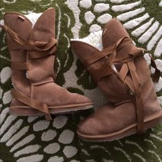 Emu suede and shearling boots Preowned with plenty of life left.  Brown suede, ties around the boot.  Size 8 but they fit a 10 well.  Run big.  Great deal!  Firm! Emu Shoes Winter & Rain Boots