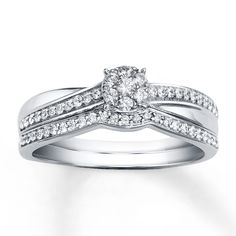 This elegant bridal set for her features an engagement ring highlighted by a circle of diamonds with crisscrossing stripes of 10K white gold and diamonds running underneath. A diamond-lined wedding band fits perfectly next to the engagement ring, bringing the total diamond weight of the bridal set to 1/3 carat. From the Now & Forever® Bridal Collection. Diamond Total Carat Weight may range from .29 - .36 carats. Diamond Total Carat Weight may range from .29 - .36 carats....