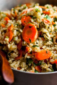 NYT Cooking: Carrots and leeks make a sweet combination, but you can also use regular onion in this pilaf. To get 1/2 cup of finely chopped parsley, begin with 2 cups leaves picked from the stems.