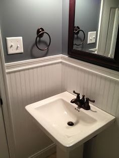 This is what I want to do in my downstairs bath. Love the beadboard.