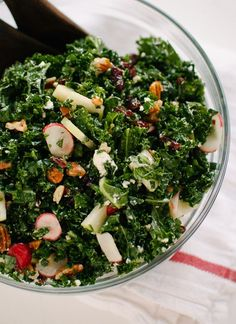Kale Salad with Apple & Cranberries. A hearty holiday-worthy raw kale salad from The Smitten Kitchen Cookbook. It's vegetarian gluten free and outrageously tasty. Lunch Recipes, Vegetarian Recipes, Cooking Recipes, Healthy Recipes, Cooking Pork, Cooking Tips, Clean Eating, Healthy Eating, Little Lunch