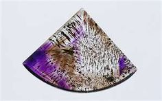 Super Seven or Sacred Seven, AKA Melody's Stone -This stone carrys the spiritual and protective qualities of Amethyst, the grounding ability of  Smoky Quartz,  the energy-amplifying properties of  Quartz, Quartz with Rutile, Goethite, Lepidocrosite and Cacoxenite.