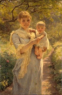 Young Mother With Her Child In The Garden