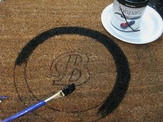 Buy cheap rug, paint on monogram using outdoor paint, letter stencil, and tracing 2 bowls for a circle frame