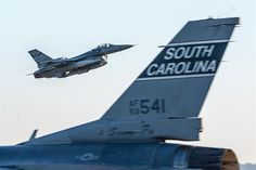 F-16 Fighting Falcon with the 169th Fighter Wing at McEntire Joint National Guard Base, South Carolina Air National Guard, takes off as one in the foreground taxis, Sept. 9, 2013. Members of the 169th Fighter Wing are conducting the certified readiness evaluation, which assesses their ability to operate safely and efficiently in a deployed chemical combat environment. (U.S. Air National Guard photo/Staff Sgt. Jorge Intriago)