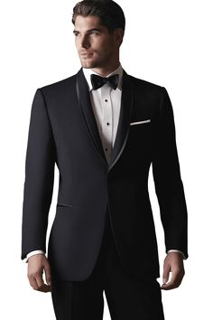 Style: 490 The Black 'Waverly' Tuxedo by Ike Behar is one of the most elegant formal options we have to offer. Similar to the Black 'Braydon' Tuxedo by Ike Behar, it features a one button single-breasted front, shawl collar, satin besom pockets, and is fashioned from luxuriously soft Super 120's wool in a slim cut for a closer, more exacting fit. The primary difference is that the 'Waverly' has a self lapel with satin trim. This tuxedo is a beautiful formal opti...