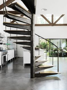 Metal spiral stair in a Hamptons kitchen