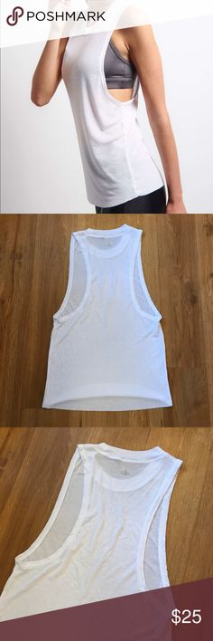 Alo Yoga  white tank top sides open size s Excellent condition alo Top Used Once size s ALO Yoga Tops Tank Tops