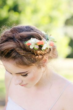 A boho-chic and romantic wedding updo with a side swept braid and colorful floral decoration ♥