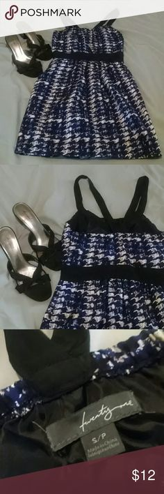 Twenty One Dress Splashes of white and cream cover a sea of blues and blacks. Adorable crisscross in the back with the black shoulder straps. Has accessable pockets!! Forever 21 Dresses