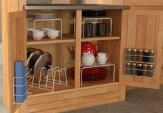 """Promising review: """"Wow. This cabinet organizer is an amazing value. So far I've used the helper shelves to reorganize my kitchen cabinet, and the wrap rack to store stuff like aluminum foil, Ziploc bags, and of course plastic wrap. I used small command hooks to hang the wrap rack from the side of my fridge. The pieces are still sturdy after a month of using them; no bending or rust. This product is an easy, affordable way to straighten up your kitchen. I highly recommend!"""" —A. E.Get the…"""
