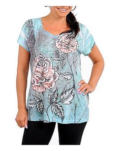 Comfortable short sleeve top has a distressed floral pattern on the front and back. Slightly sheer. outlet.com