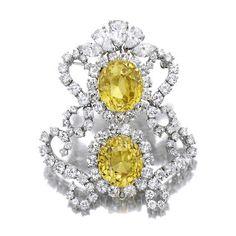 A yellow sapphire and diamond brooch