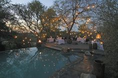 Singita Sabi Sand safari lodge, South Africa The candlelit pool at Singita Sabi Sand, a set of three elegant safari lodges on the Sabi Sand Private Game Reserve in South Africa. Hotels And Resorts, Best Hotels, Unique Hotels, Boulder Lodge, Outdoor Spaces, Outdoor Living, Outdoor Pool, Game Reserve, Interior Exterior