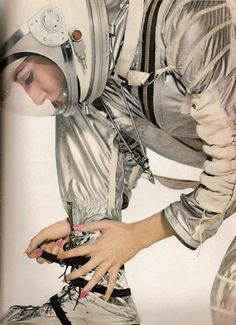 Handy hint - spice up your silver space suit with some rainbow nail polish! Harper's Bazaar Space Age fashion, April 1965, by Richard Avedon.
