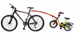 The cheaper solution than tag-along bike: Trailgator Trail-Gator Cycle T/Bar 16-20 Bike - Red: Amazon.co.uk: Sports & Outdoors