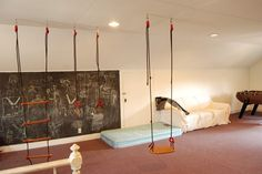 Fun Ideas for Kids Basement Playroom :: Ths kids NEED a swing inside, right? This would be easy and fun!